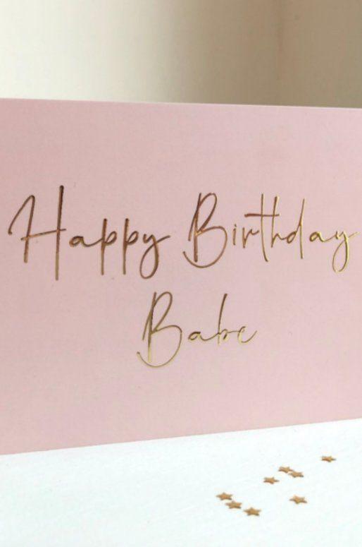 Carte d'anniversaire rose avec inscription dorée