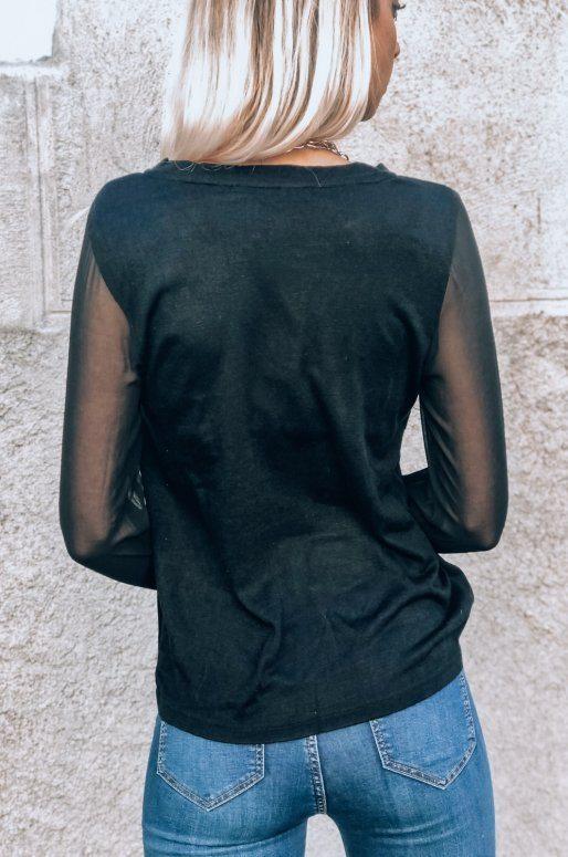 Top manches longues de couleur noir avec détails transparents
